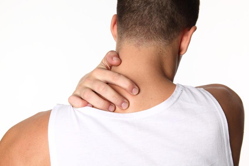 photo of someone holding neck